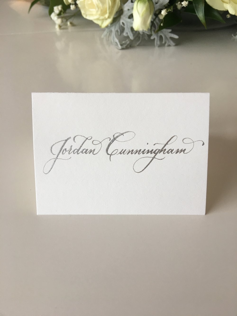 Full name on one line on place card.