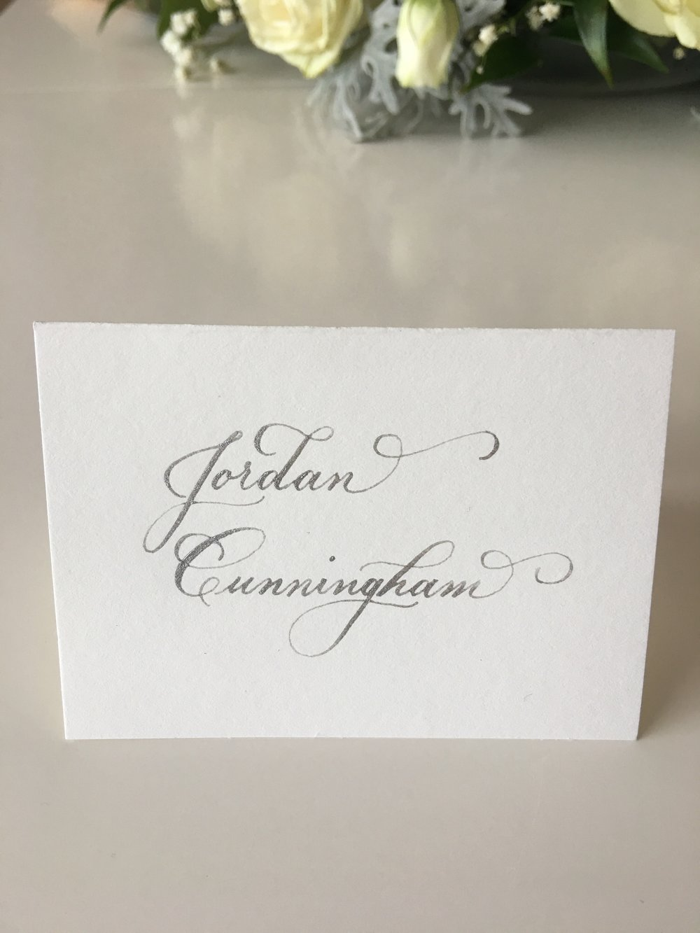 Name spanning two lines on place card.
