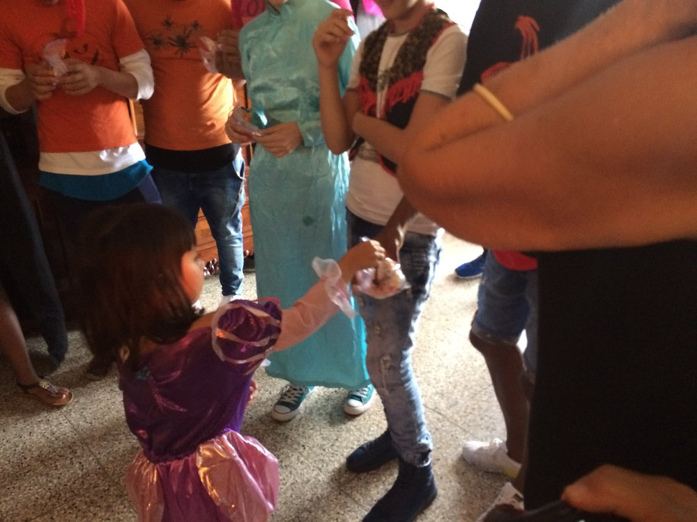 My daughter handing out candy at a party for kids' cancer survivors.