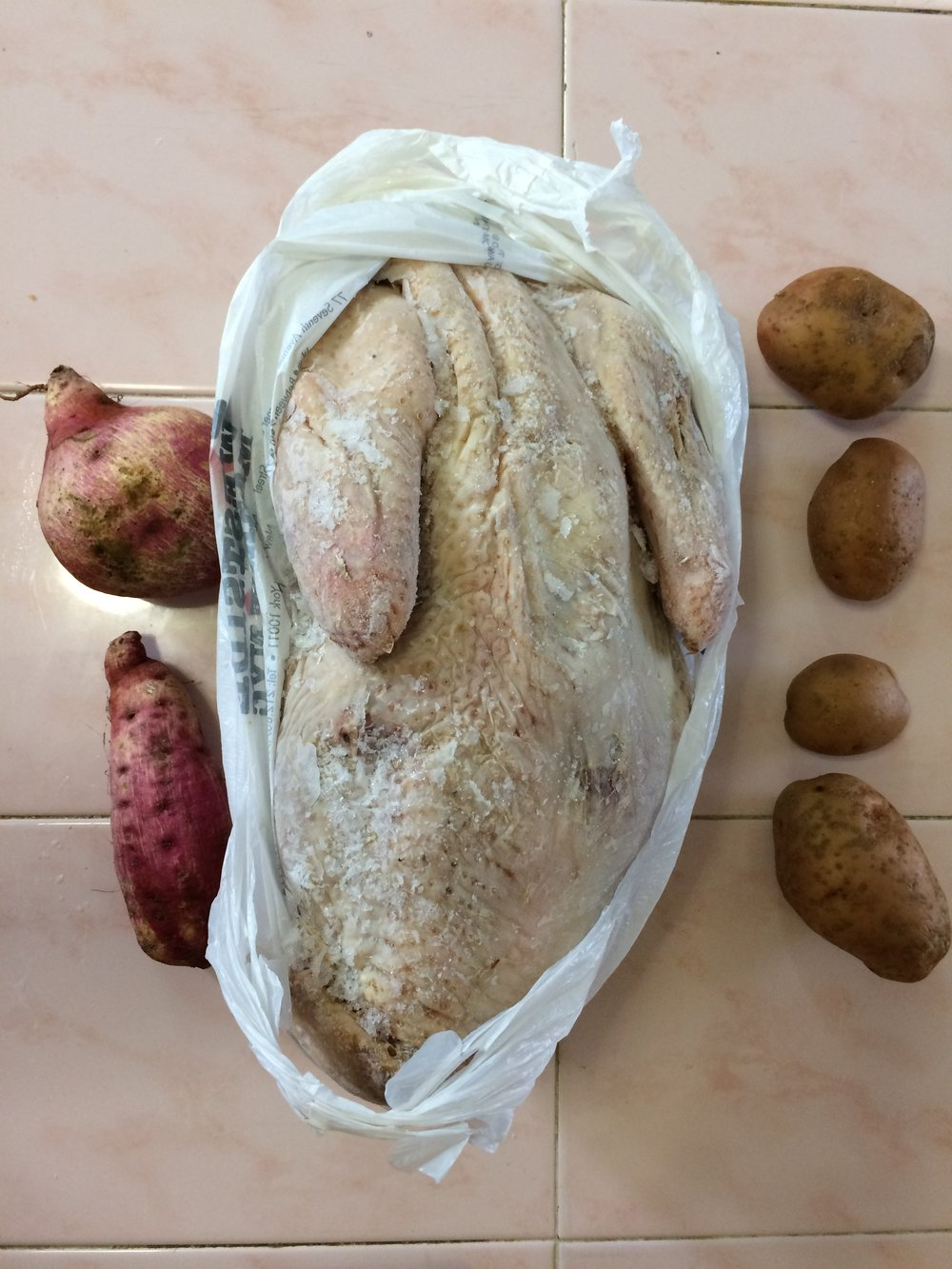 My purple sweet potatoes, a skinny Cuban turkey, and black market potatoes.