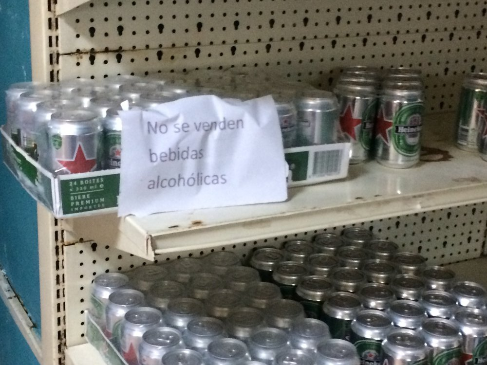 "The sign says ""no sales of alcoholic beverages allowed."""