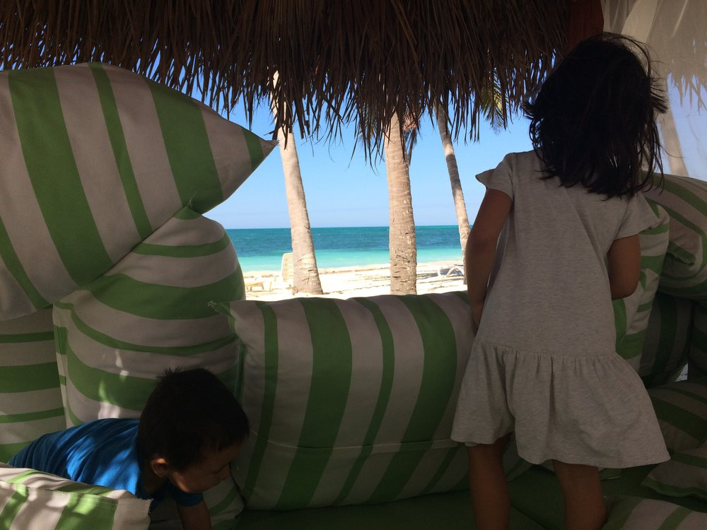 My kids building a fort in the cabana on the beach.