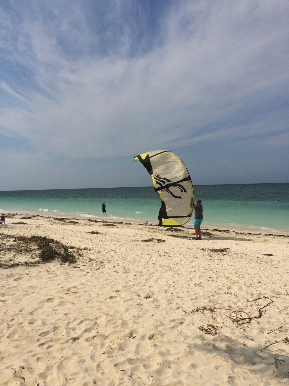 My husband launches his kiteboarding off the sandy beaches on Cayo Levisa.