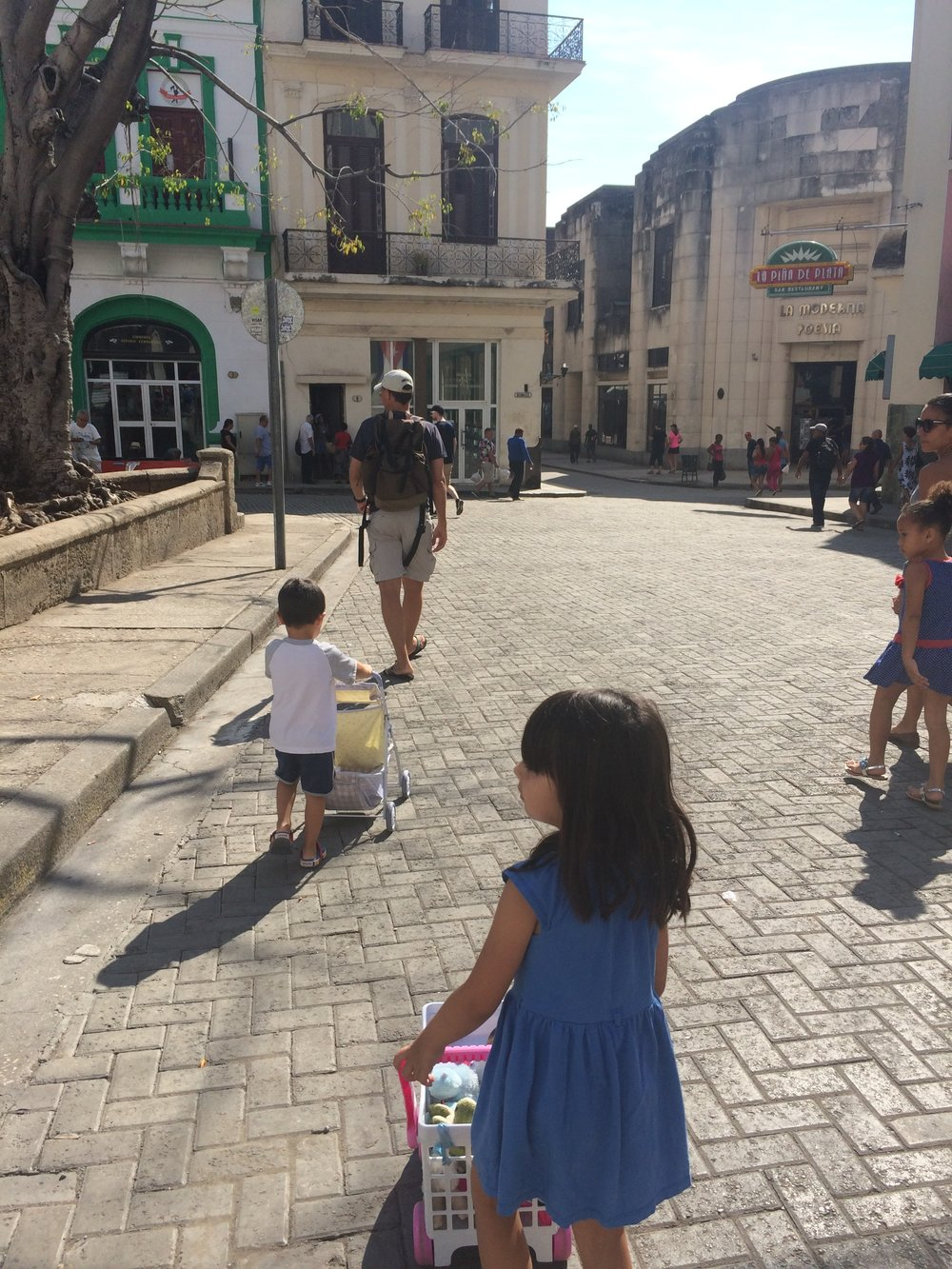Our kids, now aged 3 and 5, pushing their dolls around in Old Havana.