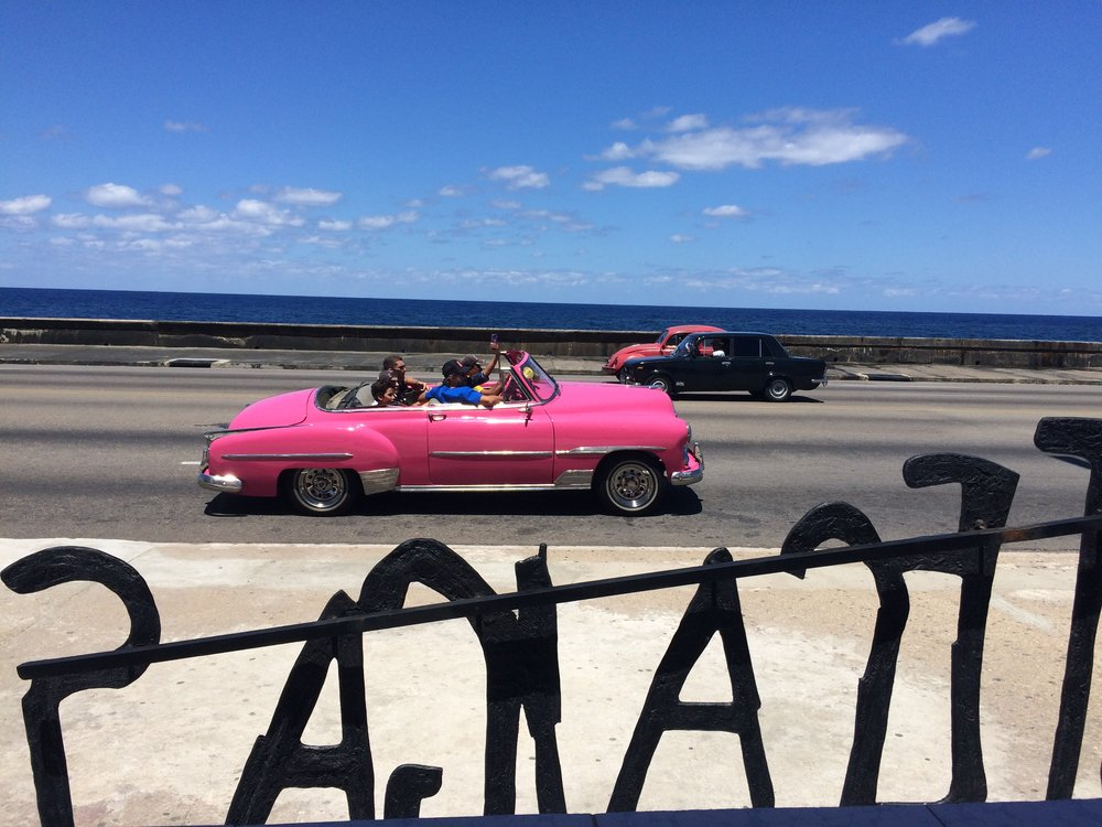 Old classic cars on Havana's Malecon.