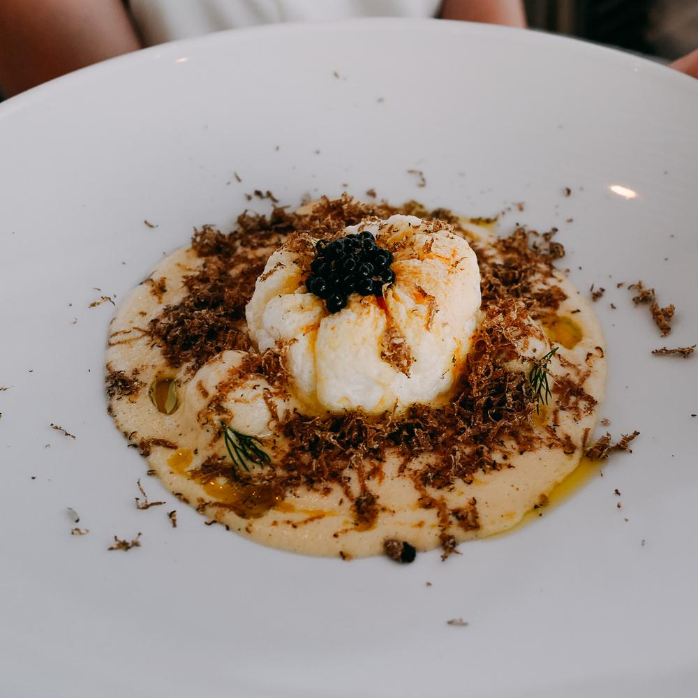 EGG & LEMON BOMB. Rooster yiouvarlakia,egg soufflé,truffle pearl.
