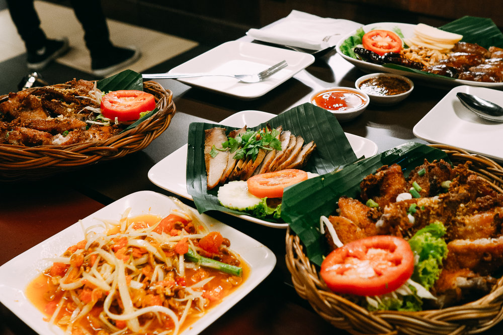 Our dinner was at Som Tum Nua, a popular spot serving northeastern Thai cuisine (Issan) with famous dishes being their papaya salads (som-tam), sliced BBQ pork neck with spicy dipping sauce, deep-fried chicken wings, along with a basket of sticky rice.