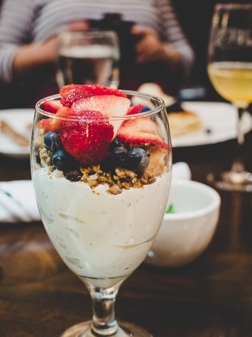 Granola, Yogurt & Seasonal Fruit.  Honey-mint yogurt, seasonal fruit, and house granola.