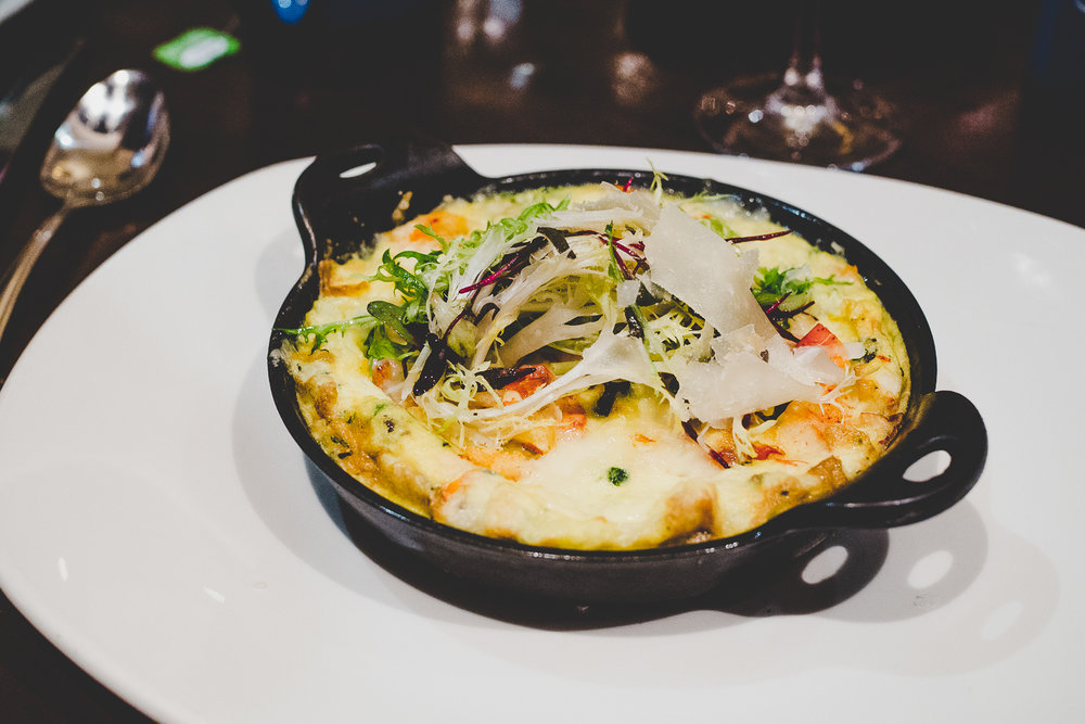 Lobster Frittata.  Fresh vegetables, Gruyère cheese, fine herbs, and petite greens.
