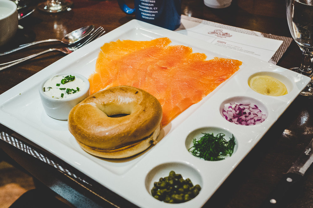 Lox & Bagel.  Lox, bagel, chive cream cheese, capers, minced red onion, and confit lemon.
