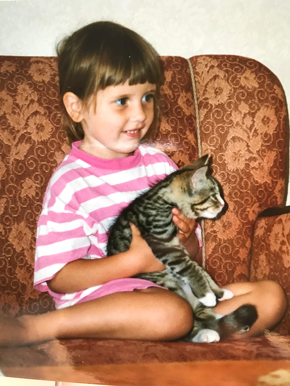 Here I am when I was four years old, with our first cat, Simba. The same year I decided I wanted to become a vet.