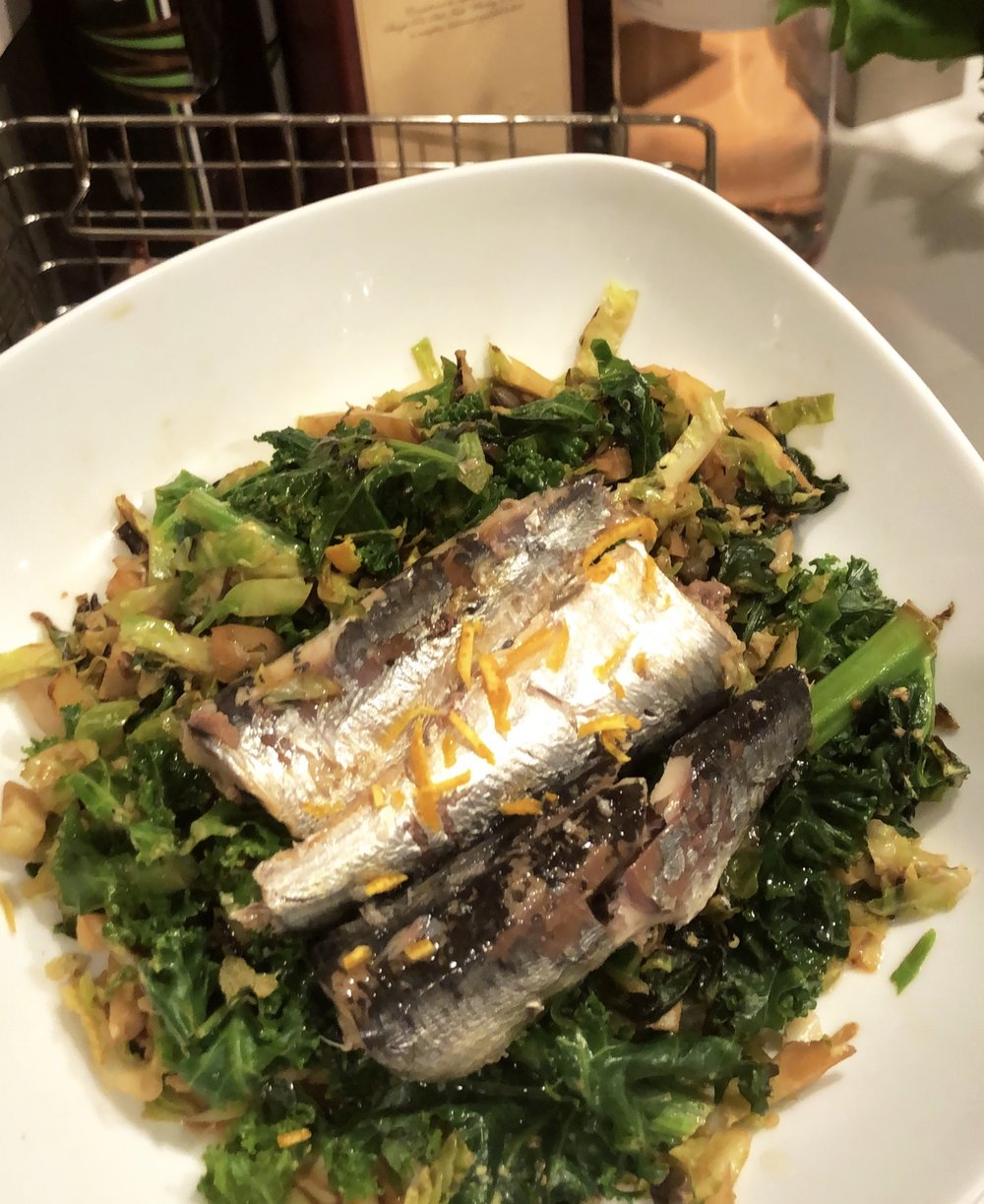 Sardines. Sauteed kale, shaved Brussels sprouts, ginger + orange zest.