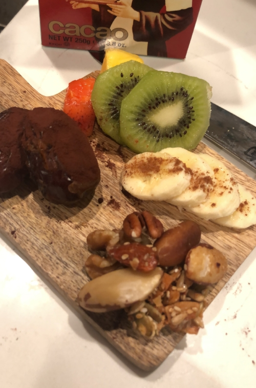 less salty more sweet. less spicy more sticky: cacao dusted date. banana w cinnamon, brazil nuts, papaya, kiwi.