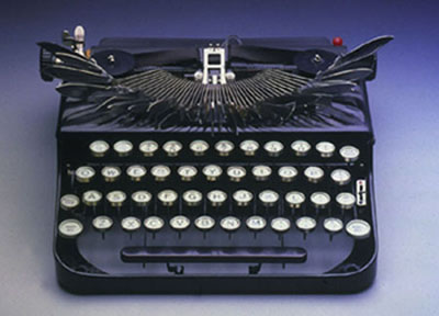 "Mel Chin, ""Dispatcher"", 1999, Austrian typewriter 1923, knife blades, 4 1/2 x 11 x 9 1/2 inches"