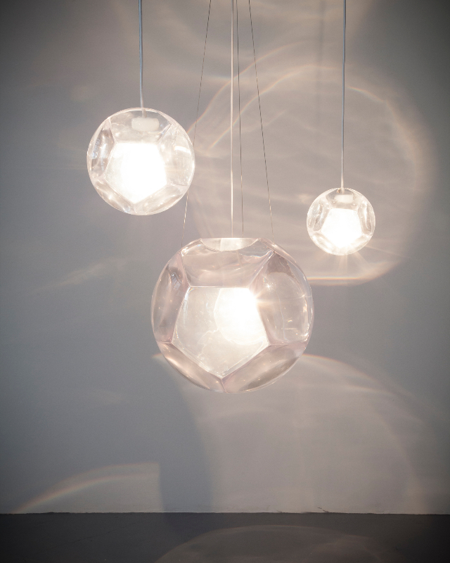 "Christian Wassmann, ""Dodecahedron"" chandelier and optical instrument with eleven clear lenses, poured polyurethane resin, installation view"