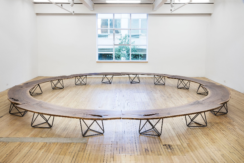 "Christian Wassmann ""Octahedron"" bench / coffee table, solid walnut slab and bent phosphorized carbon steel rod frame, 80"" L x 24"" W x 15.5"" H, installation view"