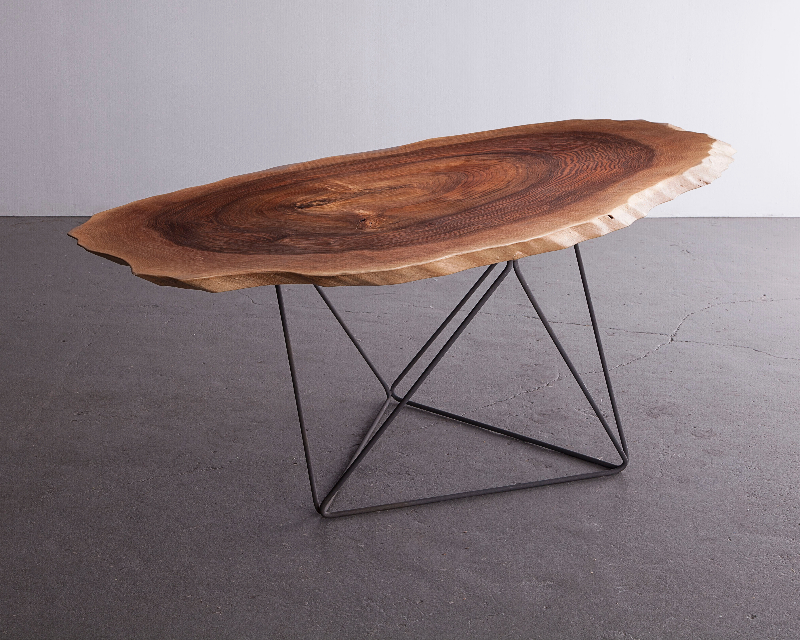 "Christian Wassmann ""Octahedron"" dining table, solid walnut elliptical slice and bent phosphorized carbon steel rod frame, 79.5"" L x 37"" W x 28"" H"
