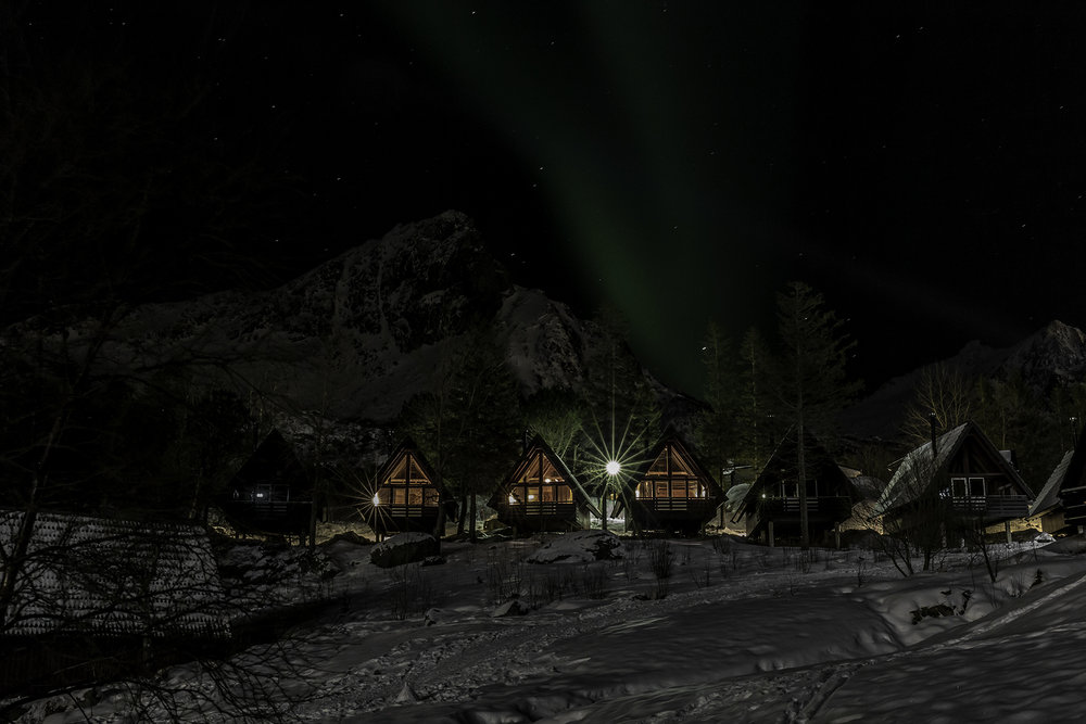 Cabins in northern light