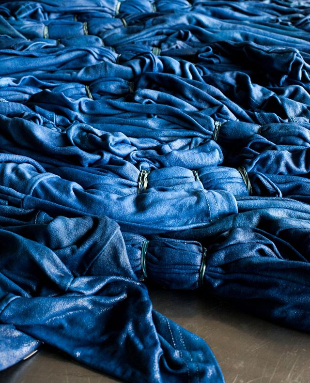 It is not that often we get to do hand tied shibori for a production order. Pictured here are the Shibori Dyed Plain T⁠-⁠Shirts for @3sixteen oxidizing after a dip in indigo. This style has sold out, but this Made in America brand has some really cool, classic styles.