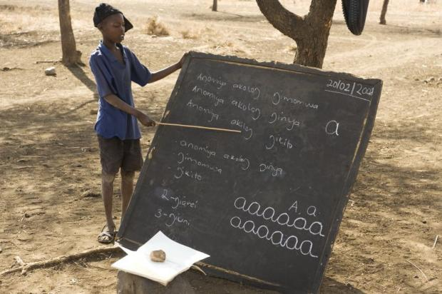 In Uganda, the cane the boy uses to show something on the blackboard is often used by teachers to discipline their pupils.