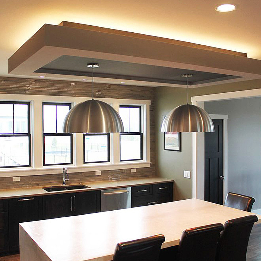 Carolyn Kinder designed Uttermost Placuna Pendant in brushed stainless over the kitchen island.