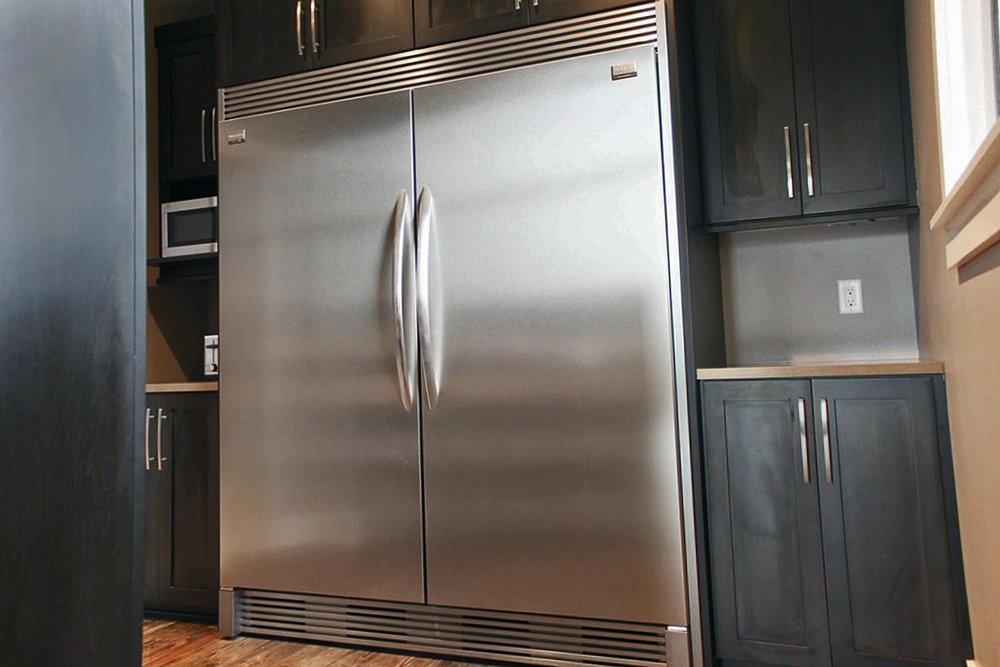A Kitchen Remodel With A double Sized Refridgerator