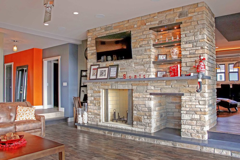 fireplace with wood storage, televison and lighted shelves