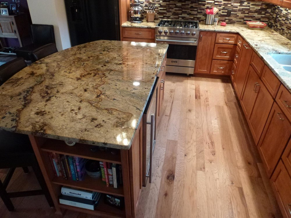 Granite Countertops and Maple Flooring