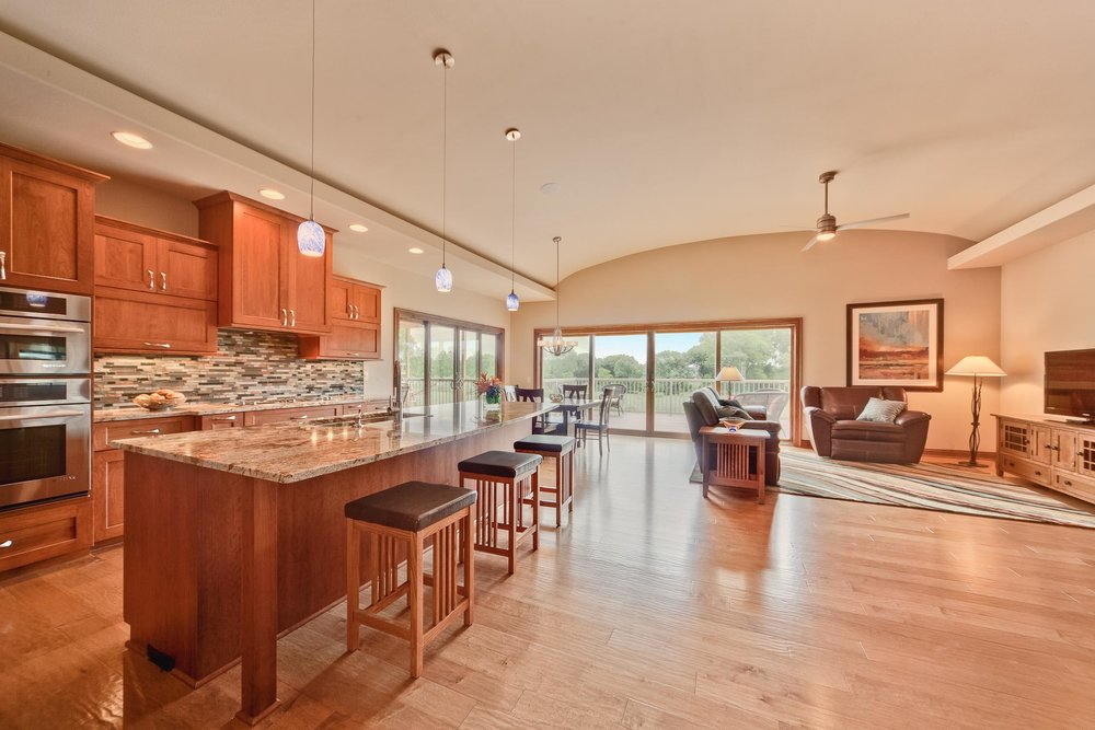 A contemporary kitchen with a fully concealed range hood behind cabinet doors.
