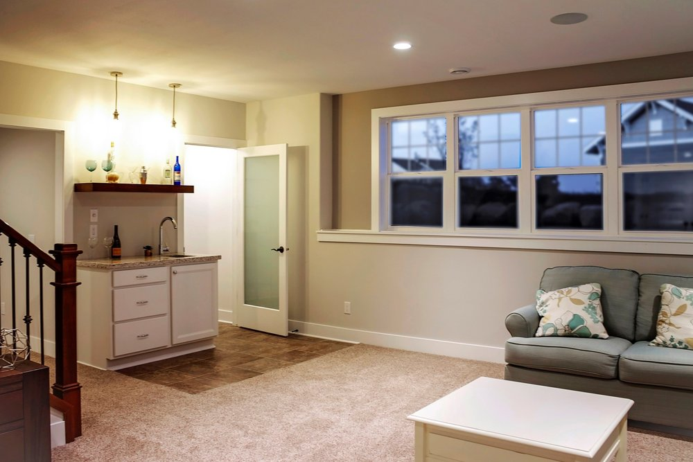 - Large windows can make a finished basement feel like it is part of the main home instead of a secondary space. Notice how the stairway leads you down toward the view in this home, rather than dumping you into a dark corner.