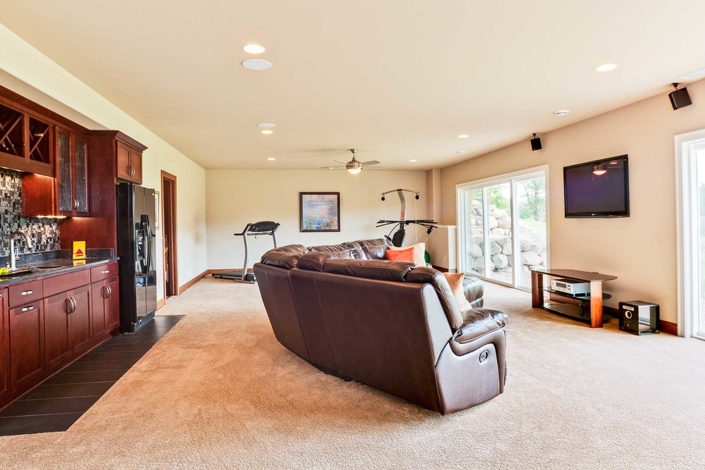 - A walkout basement provides light and access to the back yard. A wet bar is popular option in a situation like this to entertain indoors and outdoors.