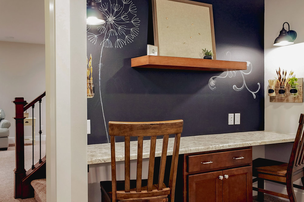 A FINISHED BASEMENT CAN BE THE PERFECT LOCATION FOR A HOME OFFICE, CRAFT NOOK, OR HOMEWORK AREA. CHALKBOARD PAINT MAKES THIS NOOK A SPOT FOR WHIMSICAL ARTWORK OR PRACTICAL LIST-MAKING.