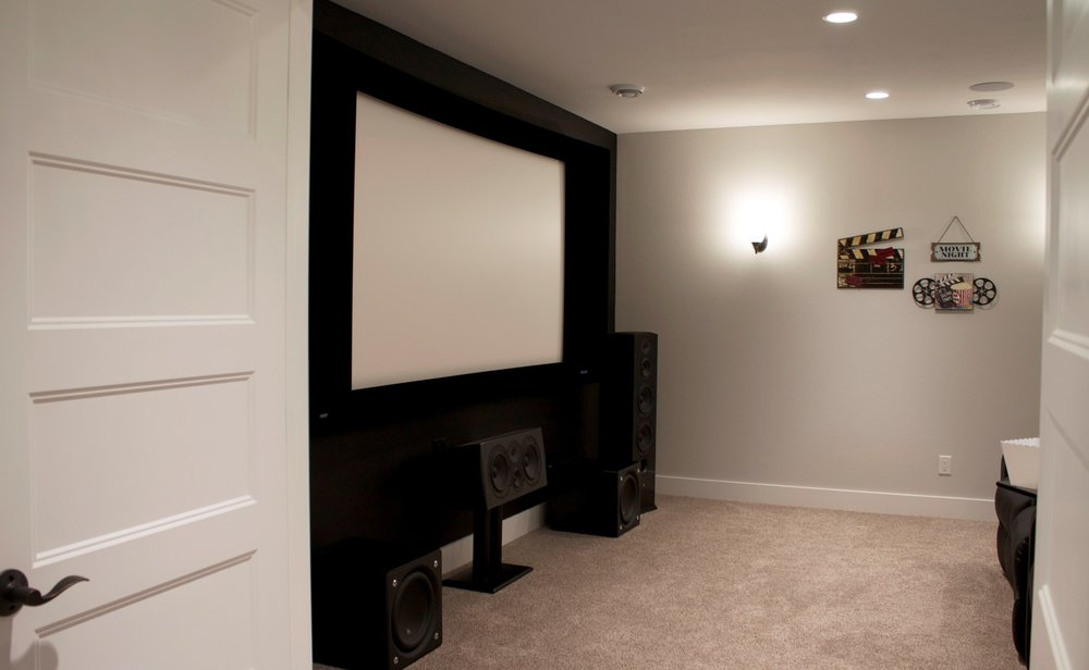 A HOME THEATER CAN BE THE PERFECT USE FOR A DARK, WINDOWLESS CORNER OF A FINISHED BASEMENT. PAINTING THE WALL BEHIND THE SCREEN BLACK CREATES A TRUE THEATER FEEL, BUT ALSO IMPROVES VIEWING BY FOCUSING THE EYE ON THE SCREEN.