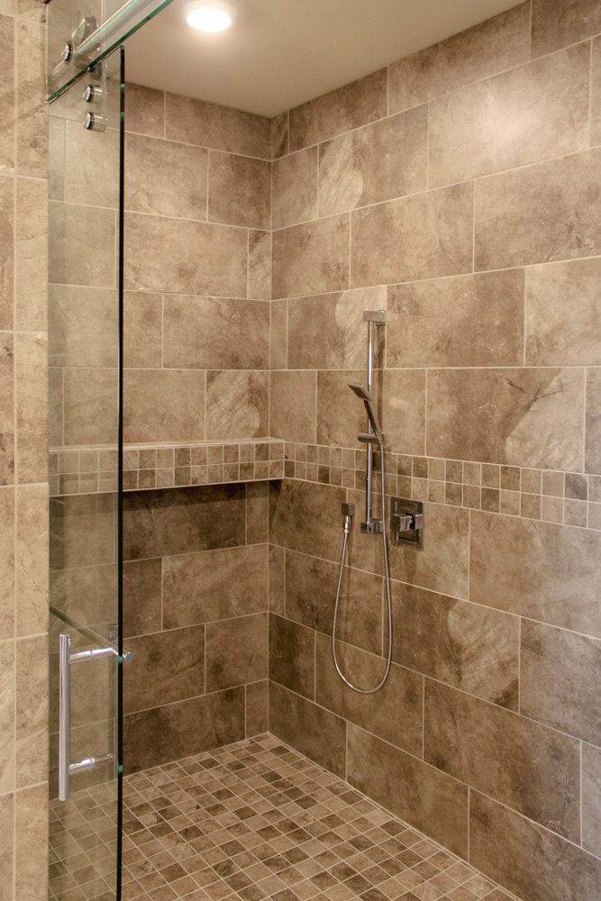 This shower is curbless and sized to be able to be accessed by the user of a wheel chair.