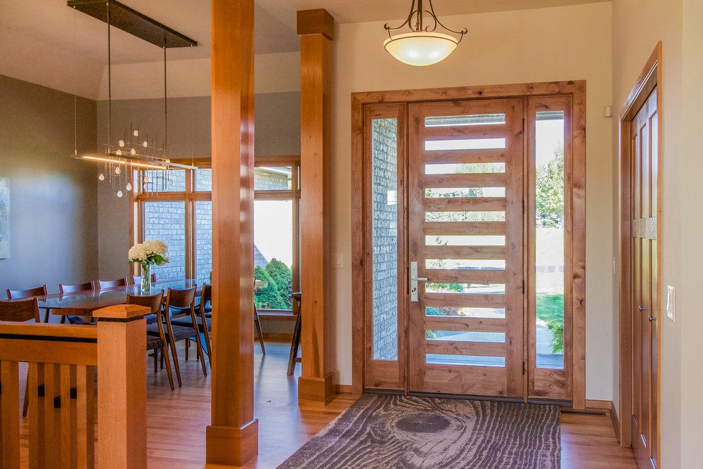 This contemporary wood door by jeld-wen was installed to transform the style of the home from ordinary to extraordinary. to learn more about the transformation in other areas of the home, follow the photo link.