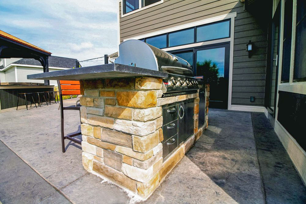 - This outdoor kitchen provides a grilling station just outside of the great room and 3-season porch.