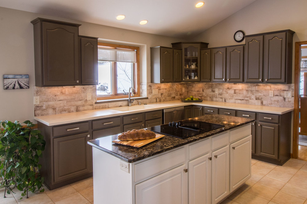 these clients chose a two-tone paint color scheme when the painted their cabinetry. it was ORIGINALLY late-1990's stained oak. the colors are a charcoal and and off-white.