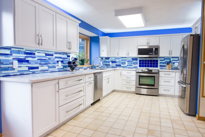 "this kitchen functions primarily as an l-shaped kitchen, with no island. But note that there is a small return for the refrigerator, making the true shape of this kitchen like a inverted ""j"" shape."