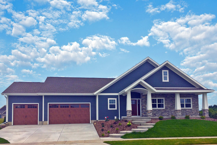- James Hardie fiber cement (cement board) siding was used on this modern farmhouse.