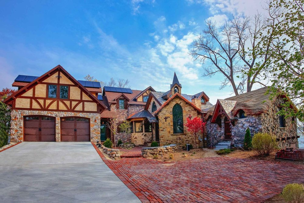 out of the ordinary: A combination of stone, brick, tudor, and stucco siding was used on this one-of-a-kind storybook lakehouse.