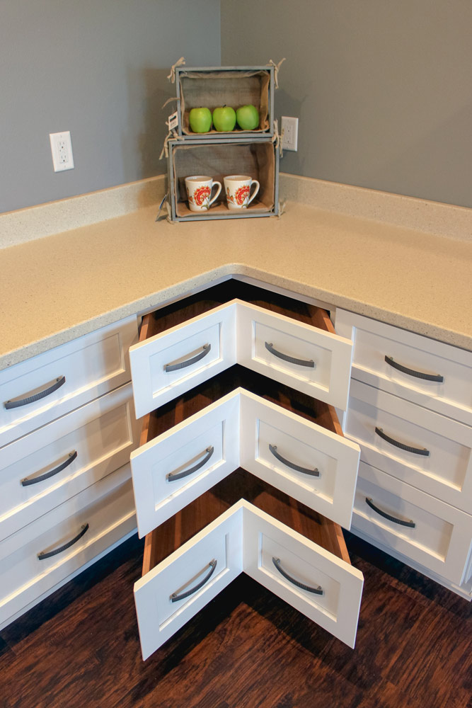 use of drawers is more effective in a universal design kitchen. avoiding deep corner cabinets is a must.