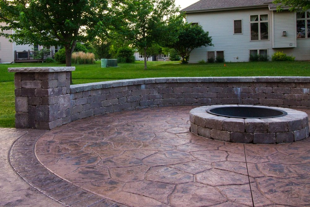 colored, textured concrete is more commonly used in outdoor patios and sidewalks than it is for interior basement floors.
