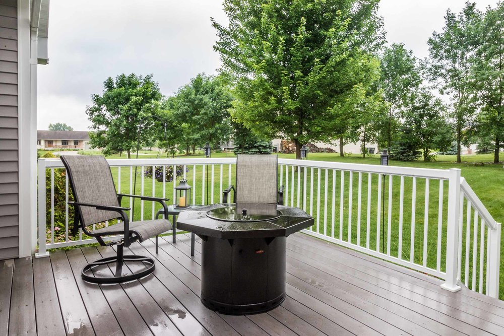 The Deck Overlooks The Back Yard and Has a Gas Fire Pit