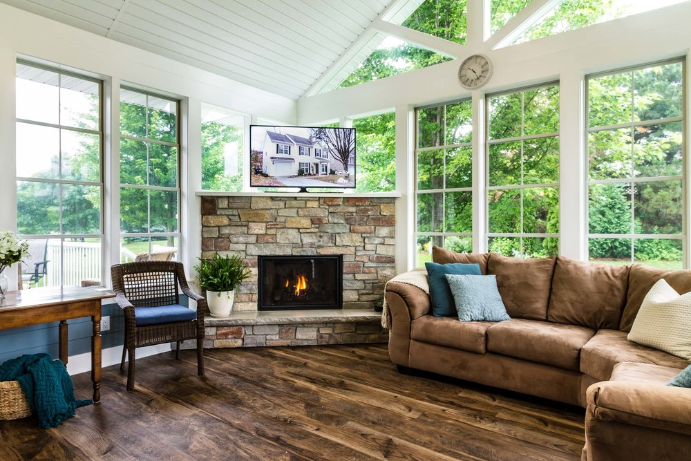 Three Season Porch Home Addition with a Kingsman Marquis Solace Fireplace