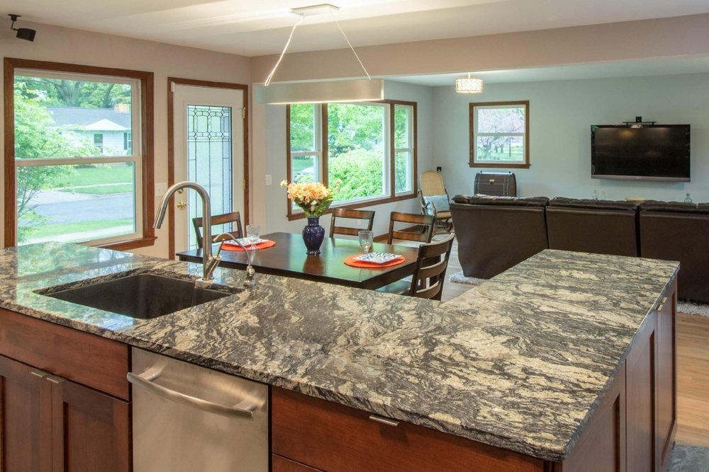 - A Blanco Silgranit sink was used in this remodel, to complement the black in the stone countertop.