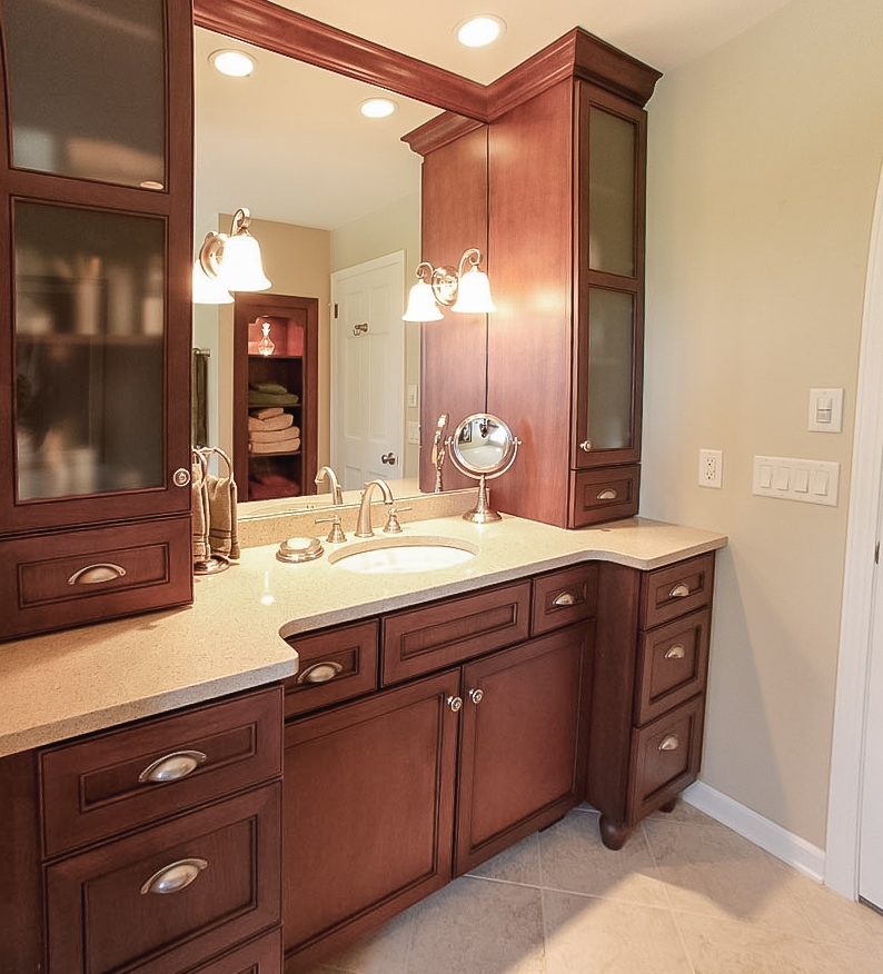A Large Vanity with Storage - Visible in the mirror, a decorative recessed niche provides linen storage, while vanity top cabinets frame the mirror.