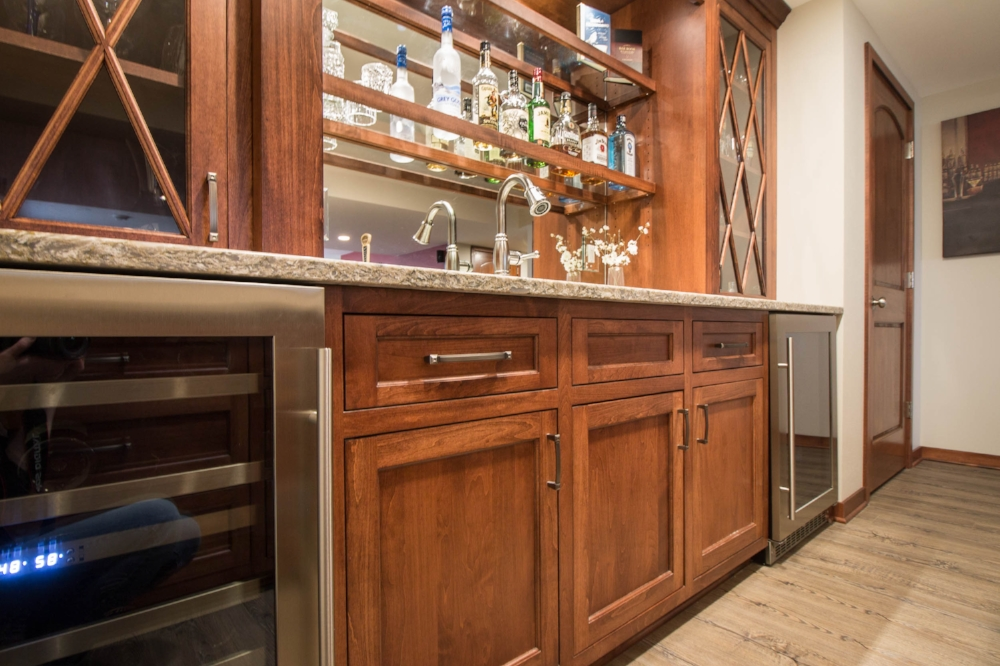Inset Cabinet Doors - This basement wet bar was completed using inset cabinet doors. Note the care taken to create uniform reveal lines between the door and the frame.