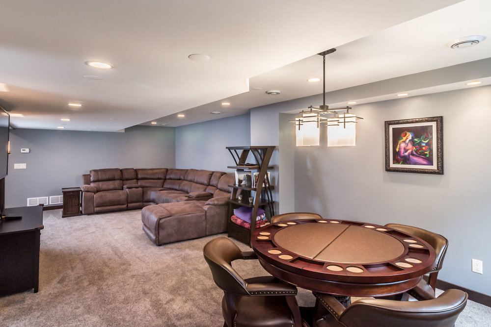 Finished Basement Remodel with Carpet Flooring