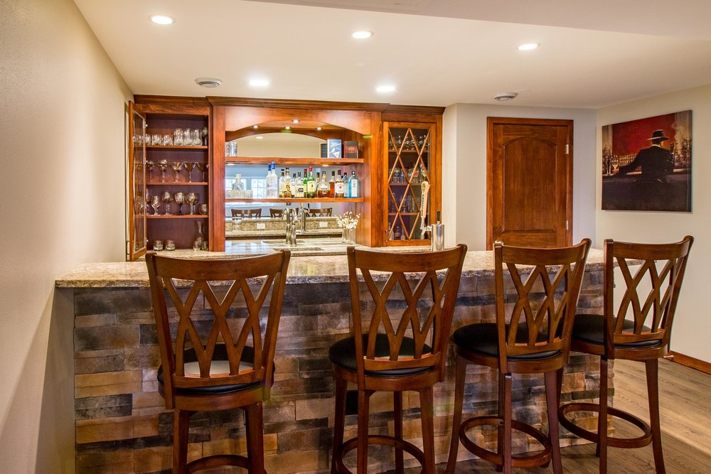 This lower level has a traditional bar layout with beer taps and the host serving as bartender.