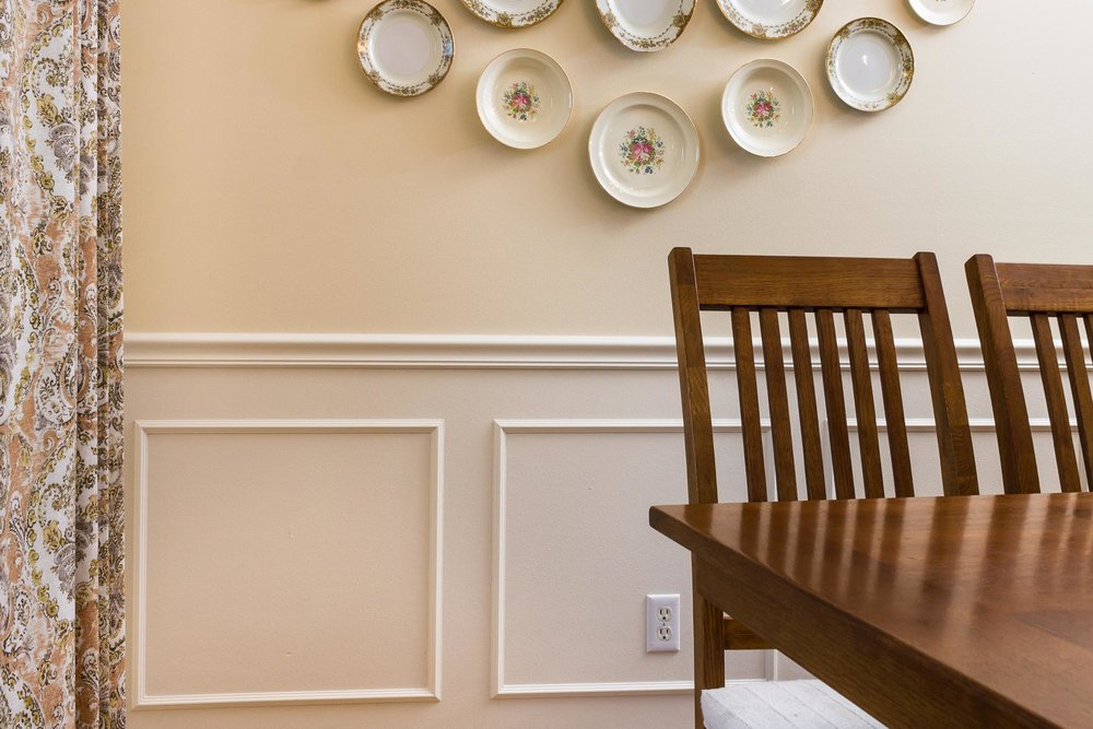 Chair Rail and Wainscot Create a Formal Feel - This Waunakee dining room has applied mouldings over drywall to create the look and feel of real wood wainscot at lesser price.